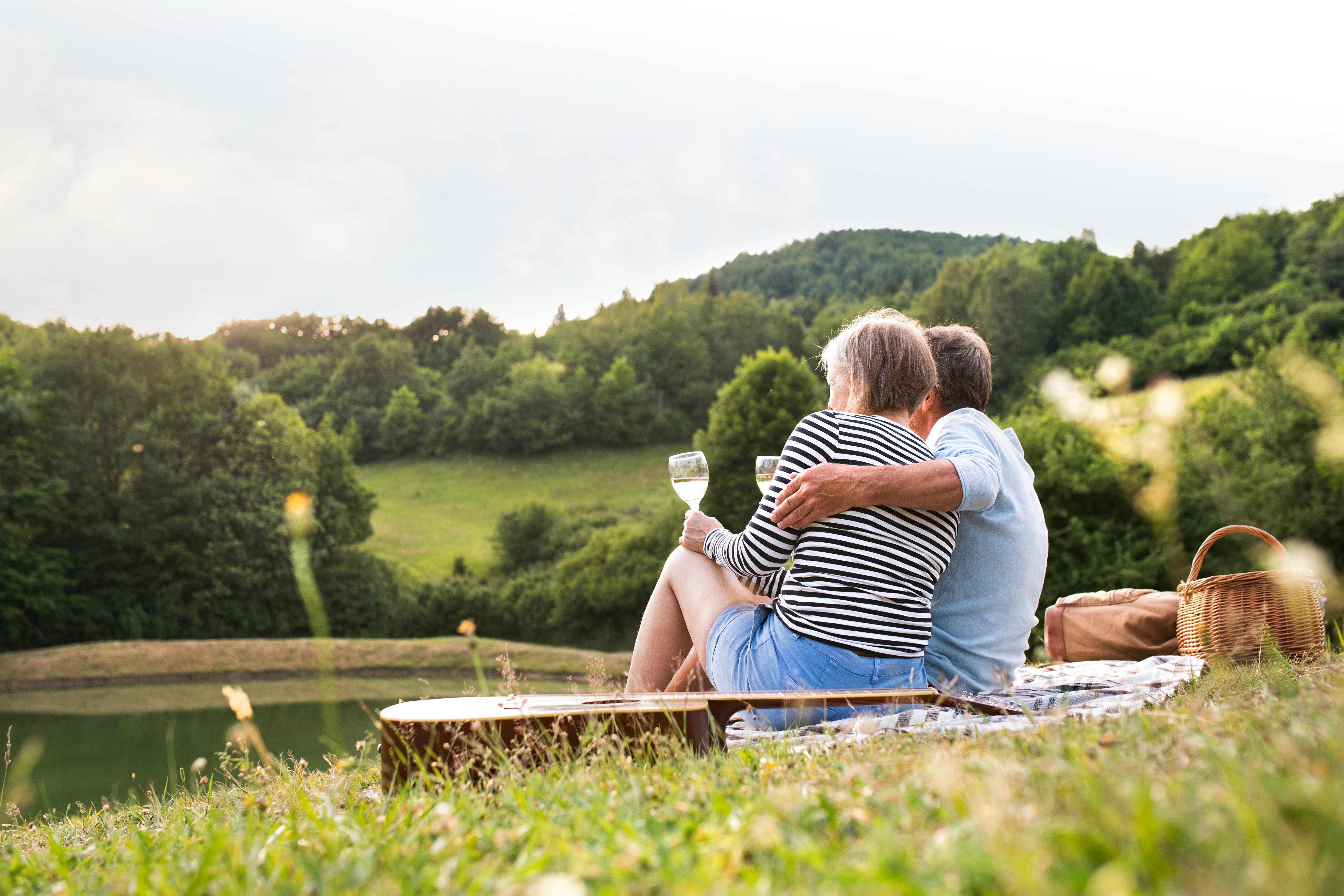 Senior couple at the lake having a picnic